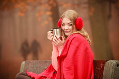 Girl with cup in park. Stock Images