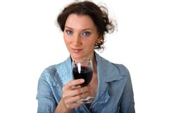 Girl with cup of red wine. Beautiful brunet girl grooving with cup of red wine isolated over white stock photography