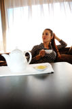 Girl with a cup of tea Stock Image