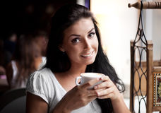 Girl with a cup of tea Royalty Free Stock Images