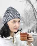 A girl with cup of tea in city park, Royalty Free Stock Photography