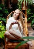 Girl with cup of tea in garden Stock Photos