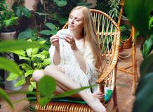 Girl with cup of tea in garden Royalty Free Stock Photography