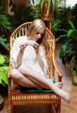 Girl with cup of tea in garden Stock Photos