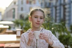 Girl with a cup of tea stock photo