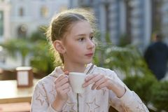 Girl with a cup of tea royalty free stock photography