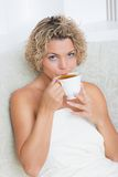 Girl with cup of tea Stock Images