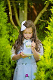 Girl with a cup of tea. Recreating of Alice in Wonderland. Girl holding a cup of tea Stock Images