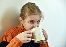 A girl with a cup of tea Stock Image