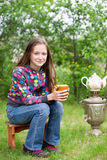 Girl with cup of tea Royalty Free Stock Image
