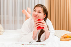Girl with a cup  thinking of something pleasant Stock Photography