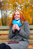 Girl with cup warm hands in yellow city park, autumn season Stock Image