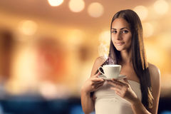 The girl with the cup stock photography