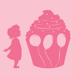 Girl And Cupcake Stock Photography