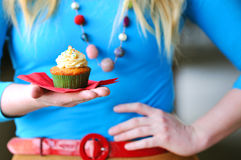 Girl with Cupcake. Cupcake held in the palm of a girl with retro stying Royalty Free Stock Photos