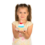 Girl and a Cupcake Royalty Free Stock Photography