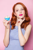 Girl with cupcake Stock Images