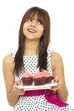 Girl with cupcakes Stock Photography
