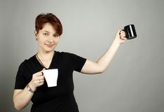 A girl with cups Royalty Free Stock Images