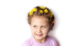 A girl with curlers Stock Photos