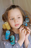 Girl with curlers in hair Stock Images