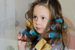 Girl with curlers in hair Royalty Free Stock Photos