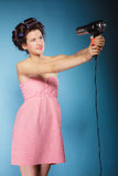 Girl with curlers in hair holds hairdreyer Stock Photography