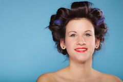 Girl with curlers in hair, woman preparing to party. Royalty Free Stock Image