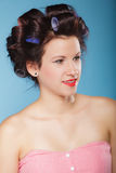 Girl with curlers in hair, woman preparing to party. Royalty Free Stock Images