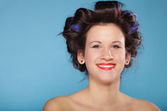 Girl with curlers in hair, woman preparing to party. Stock Image