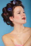 Girl with curlers in hair, woman preparing to party. Royalty Free Stock Photo