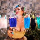 Girl hangs protective masks dried