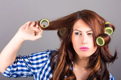 Girl with curlers. Portrait of girl with curlers stock photos