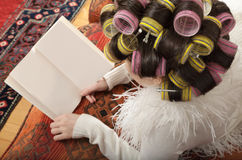 Girl with curlers royalty free stock photography
