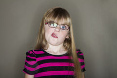 Girl curls her lips Stock Photos