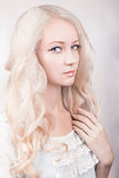 Girl with curly blond hair Stock Photography
