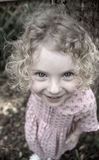 Girl with Curly Hair. A curly-haired little girl smiles in Holly Hill, FL Royalty Free Stock Photography