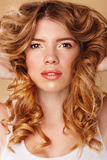 Girl with curly hair. Beauty portrait. Royalty Free Stock Photos