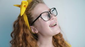 Portrait of young girl laughing towards the camera