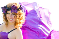 Girl with curly hair flying in the purple dress. Portrait of a beautiful girl with curly hair flying in the purple dress on the background of the river Stock Photo