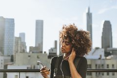 Girl with curly hair at a LA rooftop stock photography