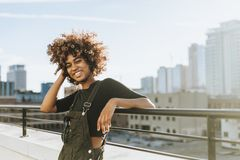Girl with curly hair at a LA rooftop stock image