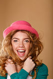 Girl with curly hair in a pink hat. Royalty Free Stock Photography