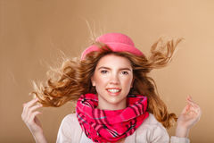 Girl with curly hair in pink hat and scarf. Stock Photography