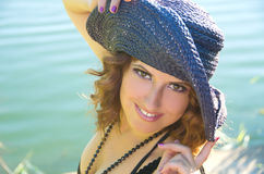 Girl with curly hair in a purple hat Royalty Free Stock Photo