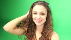 Girl with curly hair spinning  around green screen, go pro stock video footage