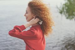 Girl with curly hair. Springtime Royalty Free Stock Photos