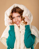 Girl with curly hair wrapped in a warm blanket. Royalty Free Stock Photography