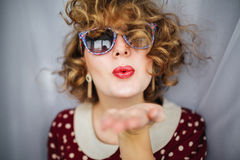 Girl with curly short hair red lips in retro Stock Photos