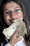 Girl with currency Royalty Free Stock Photo